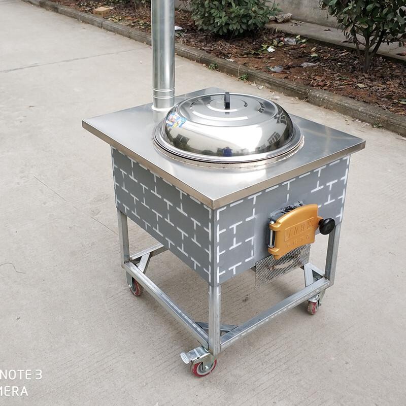 农村烧柴灶台一个锅有没有什麼讲究:就是用柴烧的那种图片