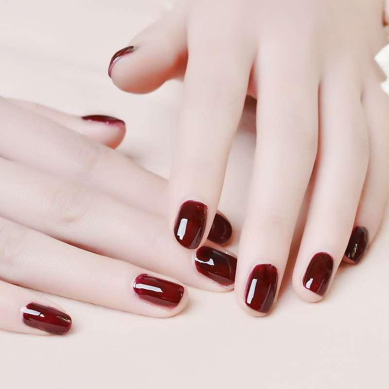 酒红手绘指甲图片